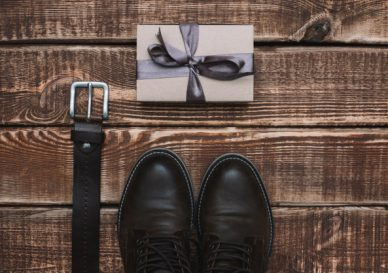 gift-box-father-s-day-with-men-s-accessories-belt-leather-shoes-wooden-table-flat-lay_182920-460